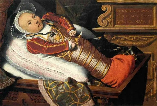 Why were some tudor babies swaddled on an inclined mattress?
